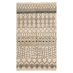 New Zealand wool rug with an abstract geometric motif. Hand-knotted in India.  Product: RugConstruction Material: