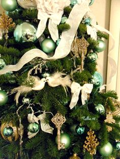 Details-Tiffany inspired, Sea-foam green ornaments, gold keys and hearts, white bows, handmade white tissue paper pom pom flowers, topped with an angel---- Christmas tree designed by Tallar-2012'