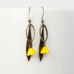 Our Yellow Longleaf Bell Flower Earring from ArtySmartyShop.com  are €18.95. These gorgeous handmade antiqued brass with Czech glass & a dangly bell flower bead are on an elegant hook,. They were inspired by the Irish countryside and turned into a contemporary piece to wear.   #artysmarty #jewelry #fashion #handmadejewelry #styleinspiration Flower Earrings, Drop Earrings, Earrings Handmade, Handmade Jewelry, Beaded Flowers, Czech Glass, Antique Brass, Countryside, Beaded Jewelry