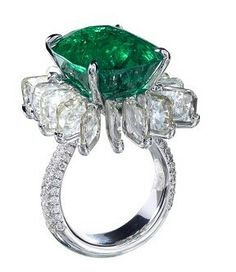 A diamond ring set with a spectacular natural Colombian emerald weighing 15.22 cts, minor oil, accompanied with Gubelin, AGL, and CDC reports; surrounded by rose-cut square diamonds weighing 7.91 cts; mounted in 18K white gold.