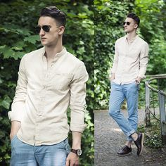 light blue denim with a tan button up and dark brown leather loafers.