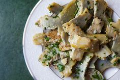 Salad of thinly sliced artichoke hearts that have been slowly poached in garlic infused olive oil and tossed with herbs.