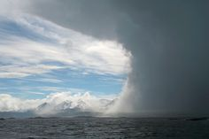 A storm spotted from a boat on the Beagle Channel in Argentina, Ushaia can be seen in the distance, commonly regarded as the southernmost city in the world.