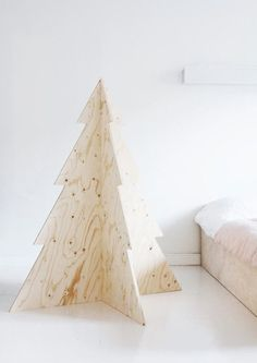 For the modern loft dweller a traditional Christmas tree might look a bit out of place. That is why we are in love with this raw plywood tree!