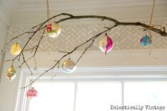 this branch window treatment - love it with the vintage ornaments!  see the Christmas house tour at eclecticallyvintage.com