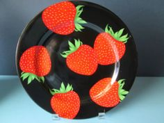strawberries on black background plate