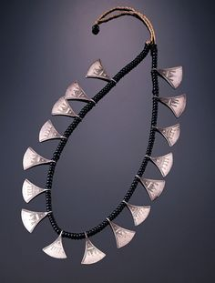"""Africa   Woman's Necklace (""""Chat chat"""") with Pendants from the Tuareg peoples, Kel Aïr group. Niger   ca. 1970/80   Silver, hammered, engraved; glass beads; cord"""