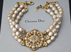 Vintage CHRISTIAN DIOR Logo Medallion Tiered Pearl by VintagEnMode                                                                                                                                                      More