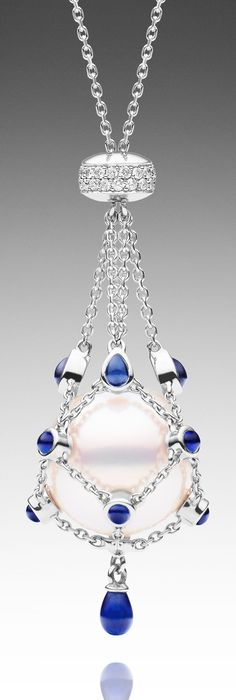 LAVALIER BLEU PETITE - ROUND   Paspaley Australian South Sea pearl necklace featuring one loose 14mm round pearl in 750 white gold with thirteen blue sapphires, total 1.32 carats and thirty-six white diamonds, total 0.16 carats, adjustable length from 40cm-79cm.