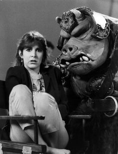 Carrie Fisher with a Gamorrean guard.