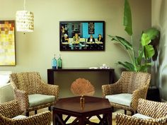 Like the pendant lamp, the simple console table under mounted tv and arrangement of seating + greenery