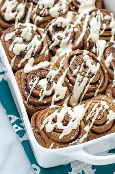 Gingerbread Cinnamon Rolls with Spiced Cream Cheese Frosting