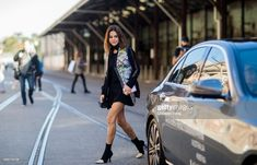Christine Centenera wearing black dress with long sleeves, vest with floral print during Mercedes-Benz Fashion Week Resort 19 Collections at Carriageworks on May 15, 2018 in Sydney, Australia.