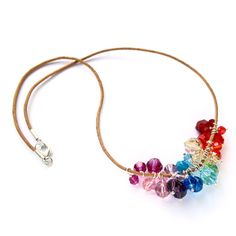 Rainbow Swarovski crystals on a leather strap.