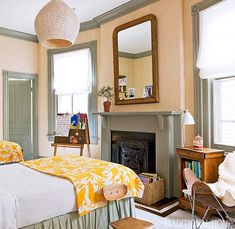 Study in contrasts:warm green paint helps the mantel pop against the peach walls