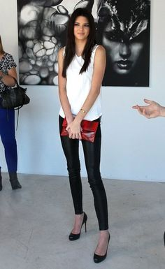 Kendall Jenner Loose Blouse - Kendall Jenner jumped on the black-and-white bandwagon with this white sleeveless top, which she paired with black leather pants.