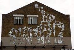 Street art by Ekta Ekta on the side of The White building, along the River Lea Navigation at Olympic Stadium on August 7, 2013 in London, England.