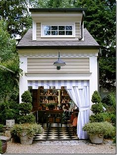 adorable garden shed...it would make a cute chicken coop too