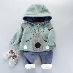 * Rabbit applique<br /> * Hooded design<br /> * Include: 1 top, 1 bottom<br /> * Material: 95% Cotton, 5% Others<br /> * Machine wash, tumble dry<br /> * Imported<br /> <br /> Keep little ones comfy and cozy in this 2-piece set featuring adorable rabbit applique and stylish hooded design.