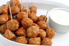 Low Calorie Buffalo Turkey Meatballs with Skinny Ranch Dressing. All the fabulous flavors of buffalo chicken wings in these NEW bite size, skinny meatballs. Each yummy meatball has only 32 calories, 1g fat & 1 Weight Watchers POINTS PLUS. http://www.skinnykitchen.com/recipes/low-calorie-buffalo-turkey-meatballs-with-skinny-ranch-dressing/
