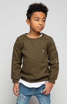Details When the stars align– magic happens! This olive green pullover is made in a soft cotton featuring a metal star embellishment, relaxed silhouette, rounded neckline, fitted cuff trim, and a zip