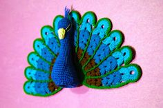 FREE PATTERN: Peacock (designed to be finger puppet, but using yarn instead of crochet thread will make a larger, toy size)