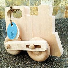 Choo choo! Here comes a beautiful handcrafted train from sustainably harvested wood with non-toxic finish.