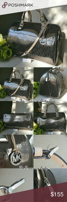 """Michael Kors MK Grayson satchel purse large bag Store display. Material has some scratches *Authentic *NWT *Style # 35F6SGYS3Z *MK Large Monogram Metallic Grayson satchel *Nickel/silver color *Leather trim *Silver-tone hardware *Zipper closure *Detachable MK emblem *Measurements: 9"""" H x 13 3/4"""" L x 7.5"""" D *6.5"""" handles *Detachable, adjustable shoulder strap *Inside slip (4) and zip (1) pockets *UPC 190049648513  Please no trades, price is firm  Same day shipping if order is placed by 3 p.m…"""