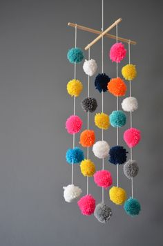 Pompom Mobile - nursery decor by marshmellodesign on Etsy https://www.etsy.com/listing/211814185/pompom-mobile-nursery-decor
