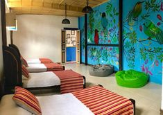 Hostales más parchados de Colombia | Travelgrafía Bean Bag Chair, Table, Trips, Furniture, Business, Design, Home Decor, Beautiful Places, Vacation Places