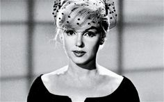 I love this pic of Marilyn Monroe with a polka dot veil...chic
