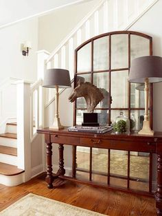 Large mirror behind table in foyer