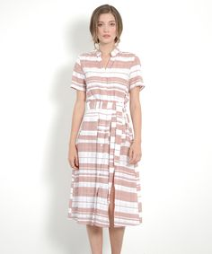 Invoke that inimitable resort getaway feeling with our Elwood Resort Maxi. Textured linen fabric, a buttoned-up front and a side slit makes for a refreshing off-duty silhouette. Make use of Elwood's accompanying sash to accentuate your waist and slip on your best sun hat, shades and wedges. Elwood's functional pockets are a great added bonus too! Available in pale blue and dusk pink.  Made of quality polyester, linenSlightly sheer, nude undergarments recommendedFront pocketsComplimentary…