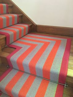 Roger Oates Fitzroy Bright stair runner with mitred landing and Pewter stair rods on oak staircase Stairs Landing Carpet, Striped Carpet Stairs, Staircase Carpet Runner, Striped Carpets, House Staircase, Stair Landing, Staircase Design, Staircase Ideas, Narrow Hallway Decorating