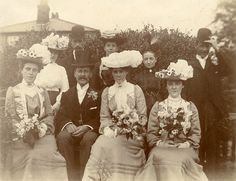 Victorian wedding group    Found image. What splendid hats! The bridesmaids have matching, slightly military outfits and the bride has a coloured dress in a different but complementary style.