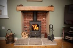 BRICK LINING - Clearview Pioneer 400 stove, reclaimed yorkshire stone hearth, oak fireplace beam, brick fireplace recess. New Homes, Country Fireplace, Home Living Room, Oak Fireplace, Home, Wood Burning Stoves Living Room, Wood Burning Fireplace, Living Room With Fireplace, Fireplace Beam
