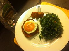Alheira Hamburger with egg and Galega Kale the Caldo Verde kale sultéed in olive oil, garlic, and bacon or tiny pieces of Presunto. to make the Alheira hamburgers take out the skin make round balls and smash a little. Put on a grill pan until golden brown. Simple and delicious. Hamburger With Egg, Hamburgers, Golden Brown, Seaweed Salad, Grill Pan, Kale, Olive Oil, Bacon, Grilling