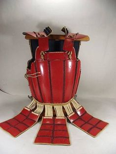 Karuta tatami go-mai sendai or yukinoshita dou. A folding (tatami) five plate, four hinge go-mai Japanese (samurai) chest armor in the sendai or yukinoshita style constricted with small square and rectangular plates (karuta) connected to each other by kusari (chain armor).