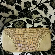 Clutch Fantastic large leather clutch with wonderful studded details. I purchased with some white marks on the sides and I'm sure someone can get them out, I never bothered since they blend in with the bag. This clutch is oversized and can hold so much stuff, I booked, phone, large wallet call my makeup bag, and much more. I still use it, just not often enough to justify keeping around. Measures 15.5wx12l (unfolded) and 15.5wx8l folded. Maya moon Bags Clutches & Wristlets