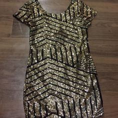 Party dress/top  Sequin gold and black dress. Perfect for nye! This dress is brand new it was just too short for my body. Best for short petite girls! :) Dresses Mini
