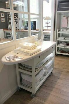 Id love a permanent ironing table like this plus a fab utility room like this to put it in...