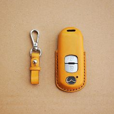 We are Mino Crafts- the Handmade Leather shop.All products are made by Vietnamese skilled craftsmen. We accept custom orders and wholesale also.#CarAccesssories, #CarKeyCase, #CarKeyCover, #CarKeyFobCover, #HandmadeKeyCase, #LeatherKeyCase, #LeatherKeyFobCover, #MazdaKeyCase, #GiftsForMen Leather Key Case, Real Leather, Minimal Wallet, Best Boyfriend Gifts, Car Key Fob, 2 Keys, Handmade Leather Wallet, Sewing Leather, Mother Gifts