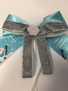 A personal favorite from my Etsy shop https://www.etsy.com/listing/223265922/disney-frozen-inspired-satin-hair-bow