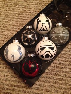 These glass ornaments are 3 inches by 3 inches. This set includes Darth Vader, the Death Star, a Storm Trooper, and the Empire, Jedi, and Rebel