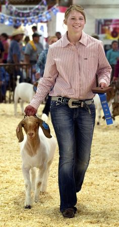 Shelby Teague, 16, of Fort Morgan, leads 22 from the ring after winning the senior market goat showmanship contest Thursday during preliminary competition of the Colorado State Fair Junior Livestock Show. (Chieftain photo by Chris McLean, Aug. 23, 2012)