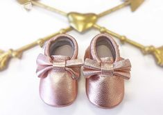These Rose GoldBaby Moccasins are made with 100% genuine leather. These Moccs are constructed with elastic at the opening to easily slip on & off, but also