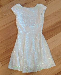 pretty and sweet, love the simple silhouette, high neckline and the sparkle -- Sneak peak... Winter formal dress!