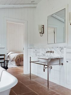 Required Reading: Freemans Food & Drink by Taavo Somer floor tile, sconce, mirror, white, marble sin Chic Bathrooms, Dream Bathrooms, Beautiful Bathrooms, Modern Bathroom, Luxury Bathrooms, Kitchen And Bath Remodeling, Bathroom Renovations, Carrara Marble Bathroom, Bathroom Sink Vanity