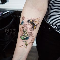 watercolortattoo dragonfly and lowerstattoo by @coosomno