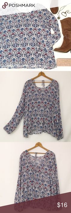 Boho paisley scoop back tie neck top Excellent condition !   100% rayon.  scoopneck with slightly deeper scoop at rear.  Braided ties.  Elastic at sleeve cuff.  Oversized, flowing fit.  🔹Bust 51  🔹length 26 front, 27.5 rear   🎀 Price is non negotiable. 🎀 I'm happy to bundle to save on shipping costs, however no additional discounts are available. Garage Tops Blouses